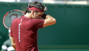 Roger Federer, citing back, knee injuries, withdraws from French Open